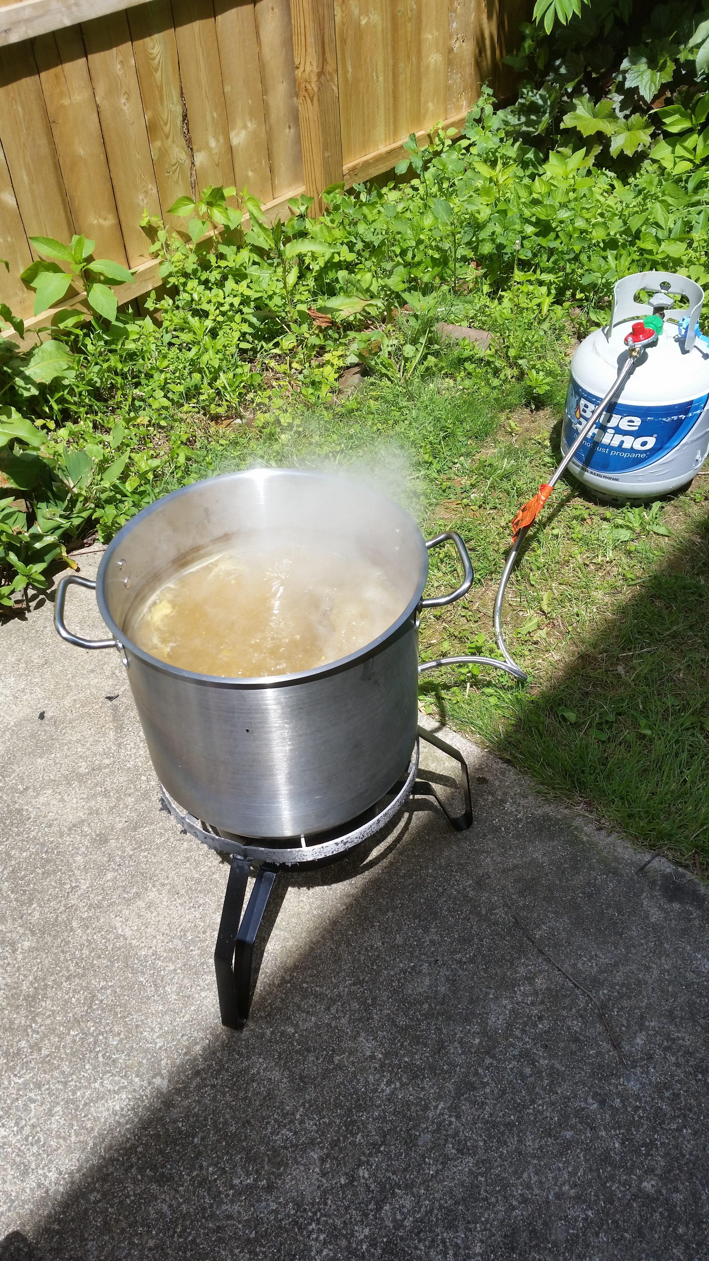 Home-brew beer boils on outdoor burner.