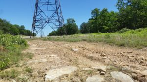 Hardscrabble dirt and power line