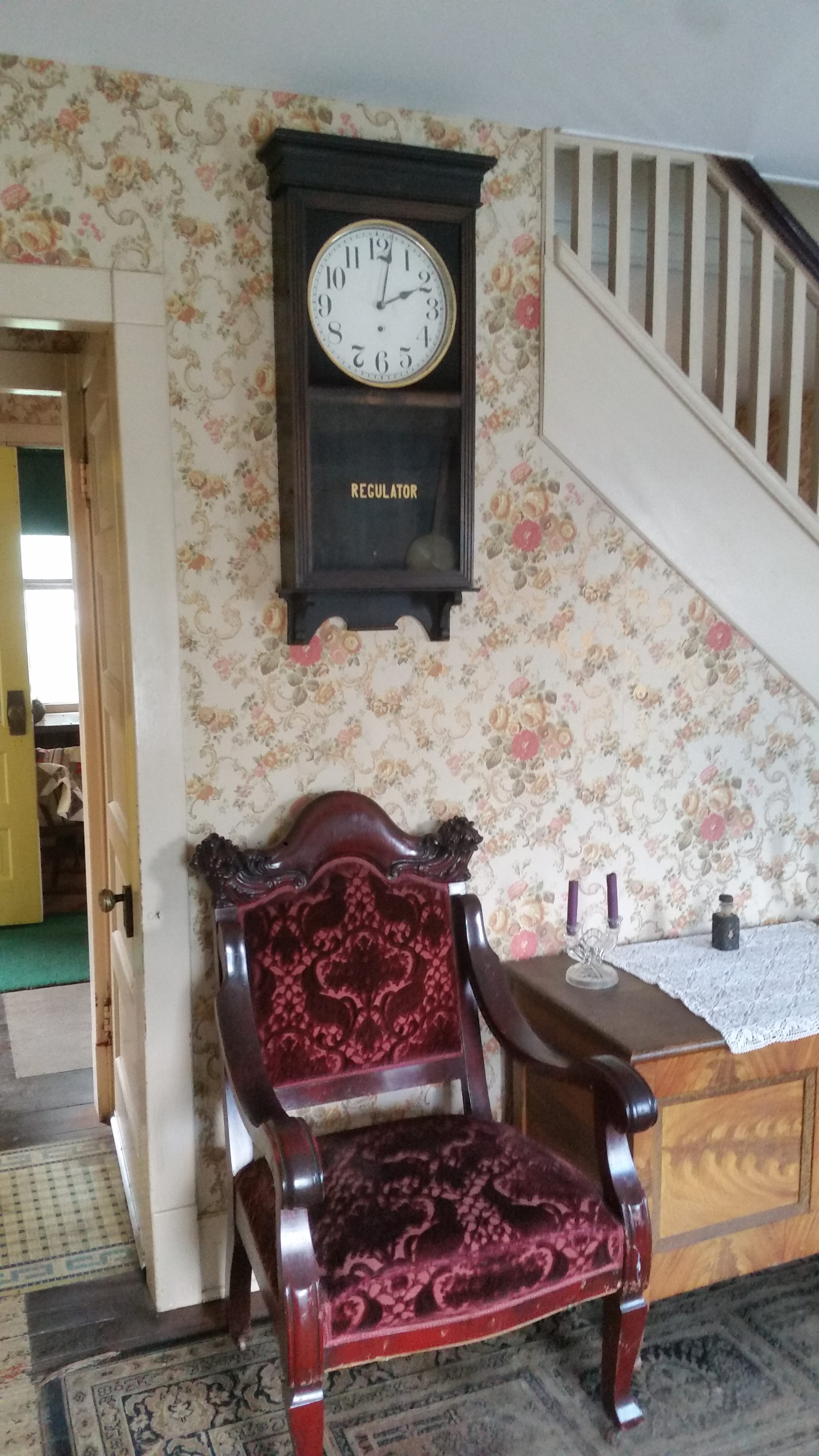 clock on wall above chair