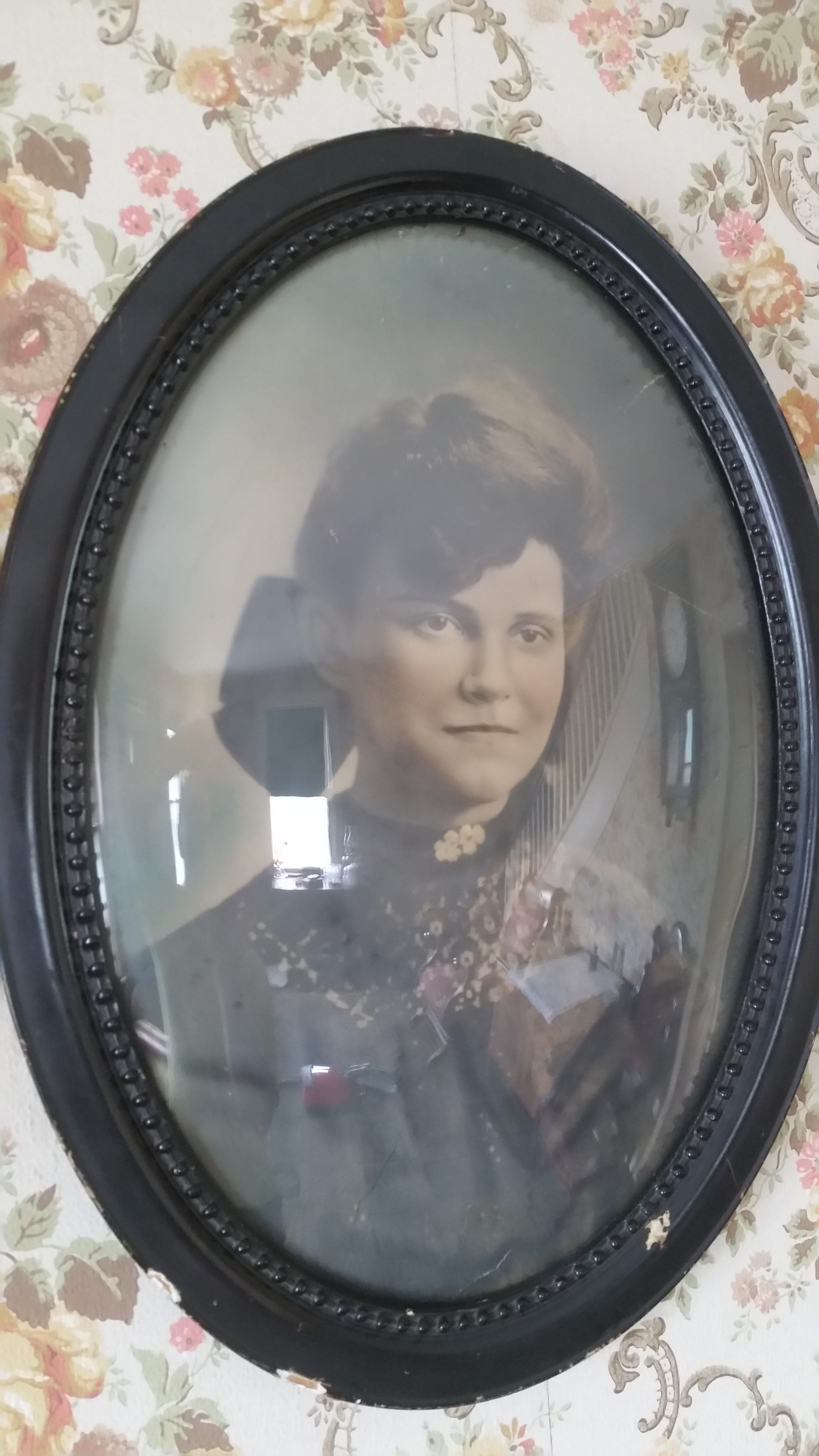 old-timey portrait photo of young woman