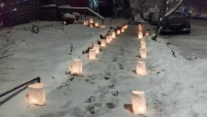 candles in bags on sidewalk