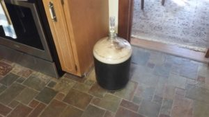 beer brewing in glass jug