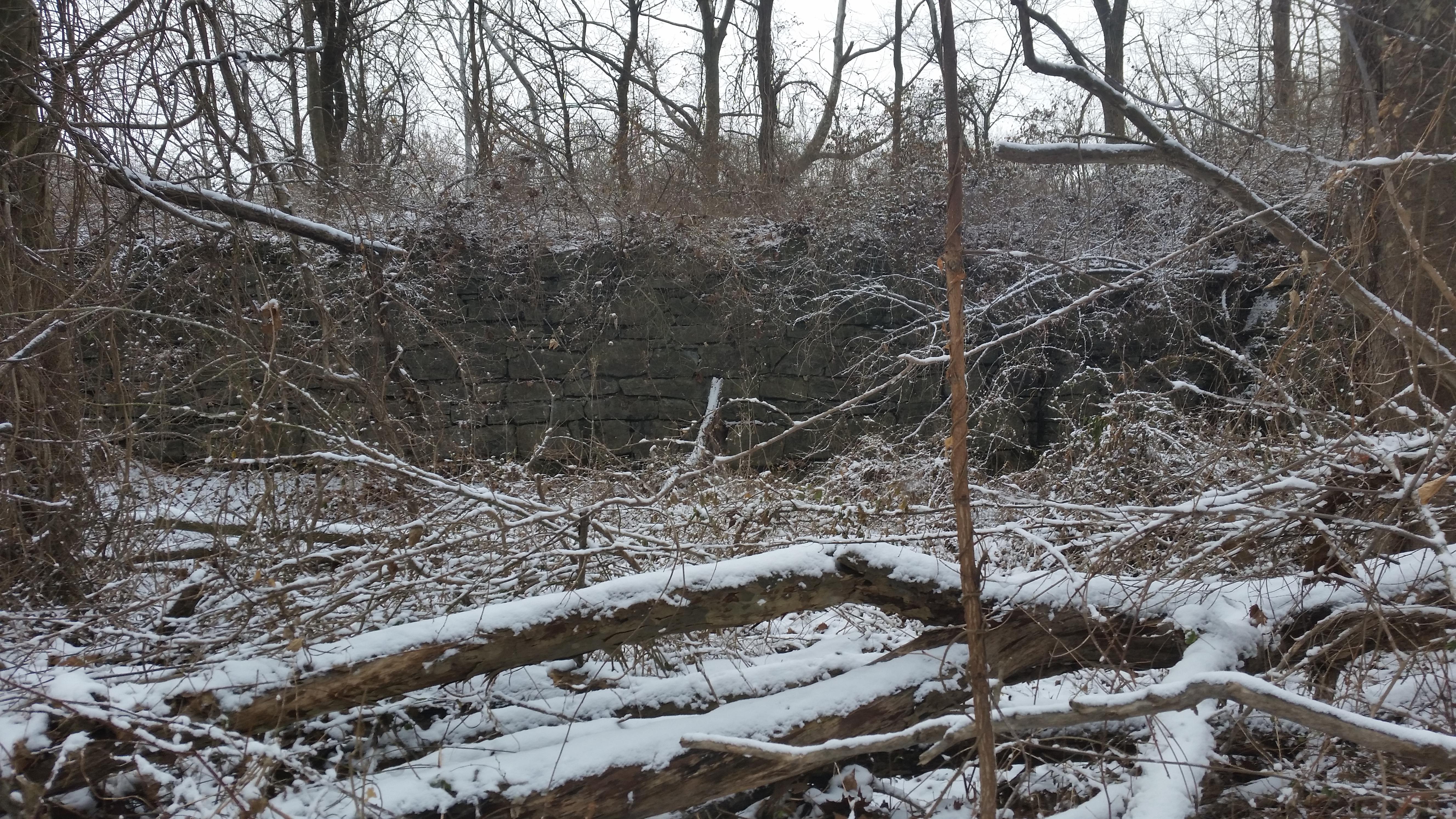 masonry wall in snowy woods