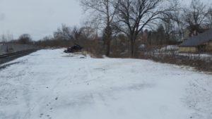 snowy railroad tracks and brush