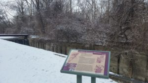 snowy canal and ruins of a lock