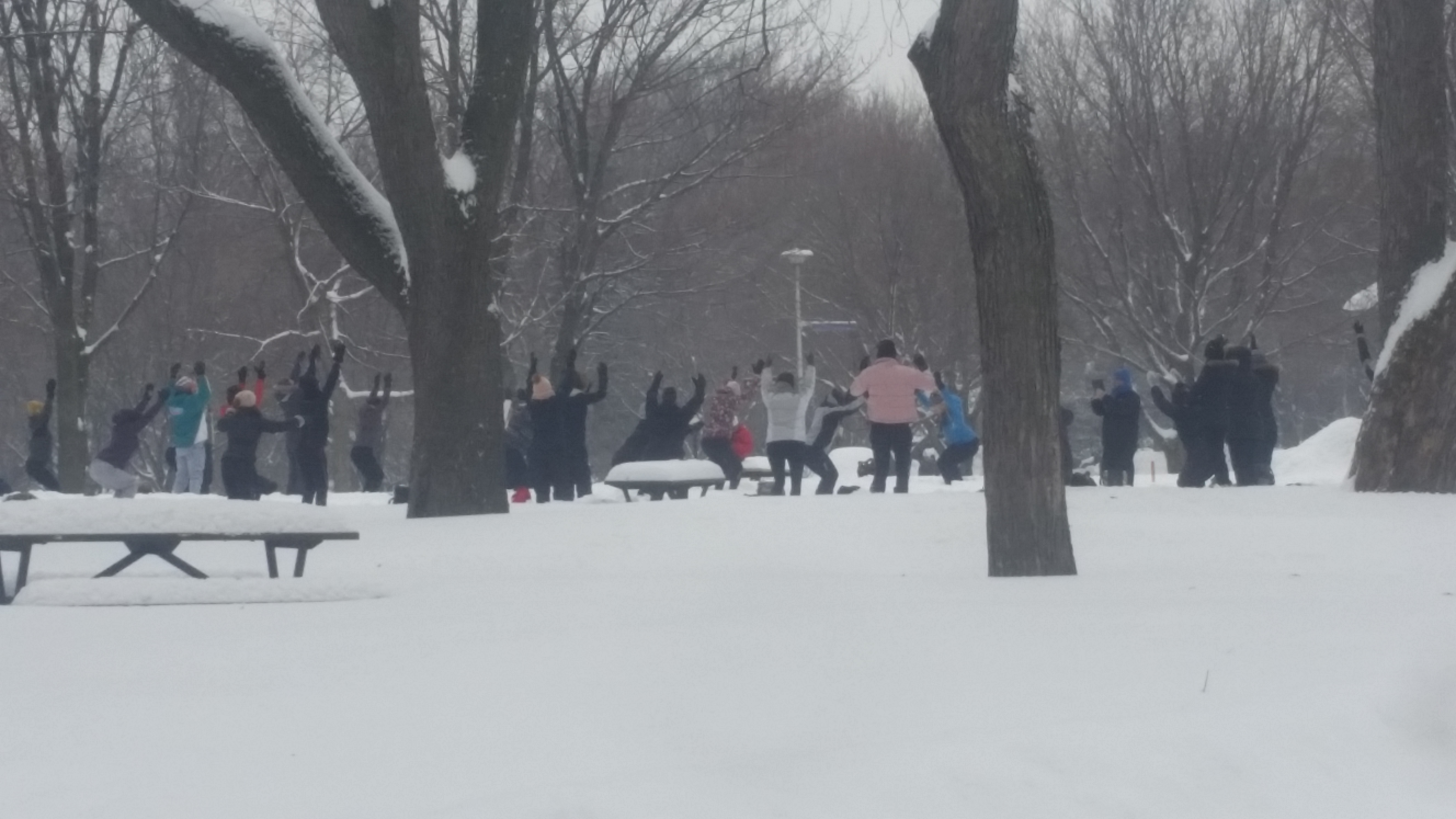 outdoor yoga class in the snow