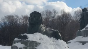 lion statue with snow