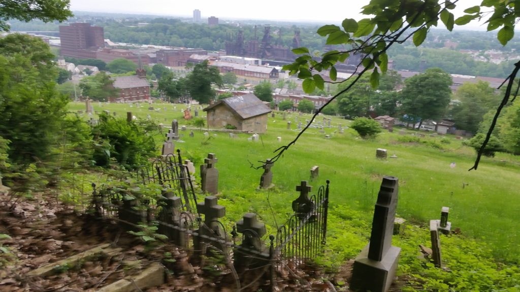 old cemetery with city in background