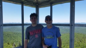 men stand in fire tower