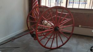 fire hose on wagon wheels