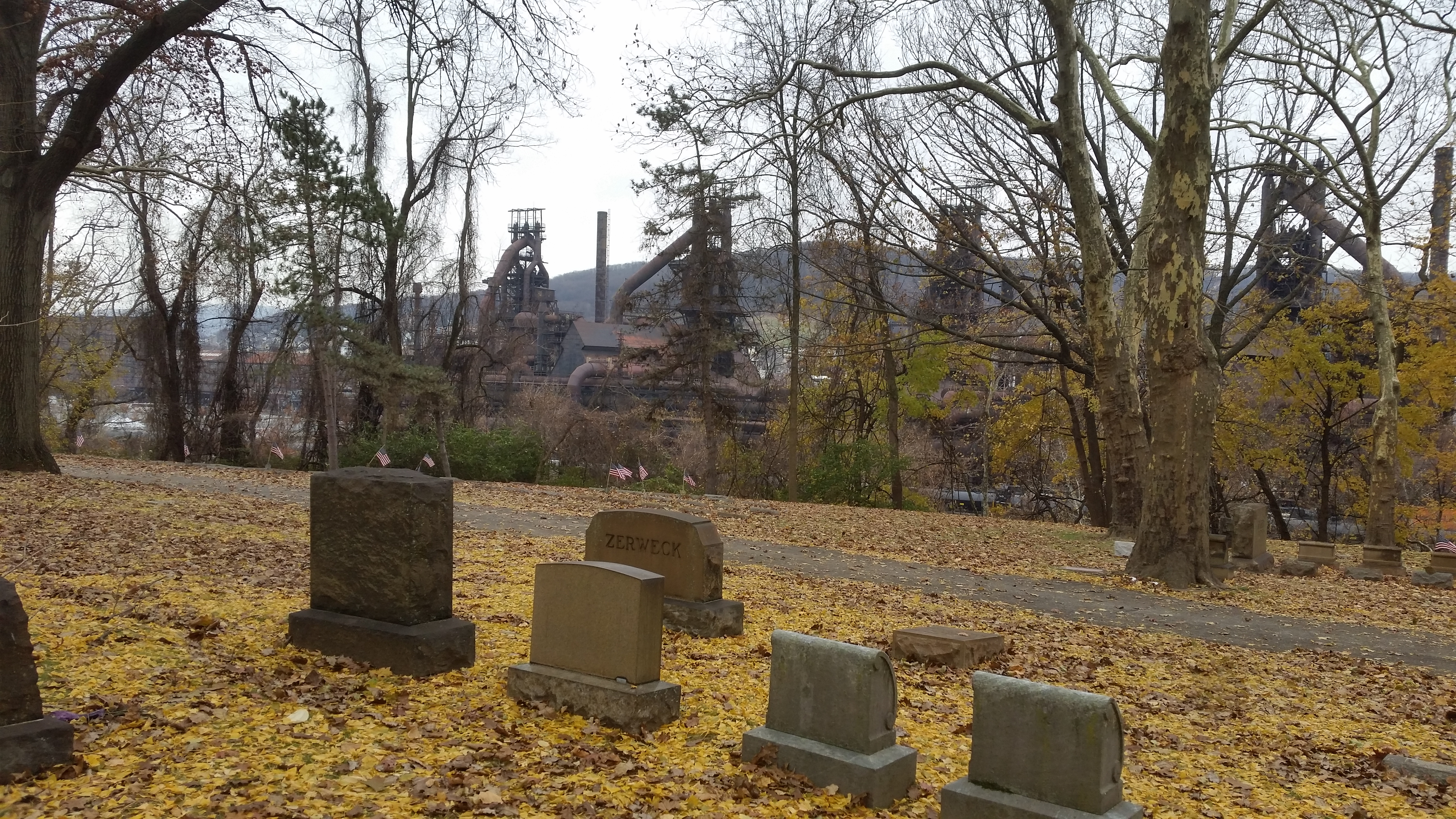 cemetery scene with industry in background