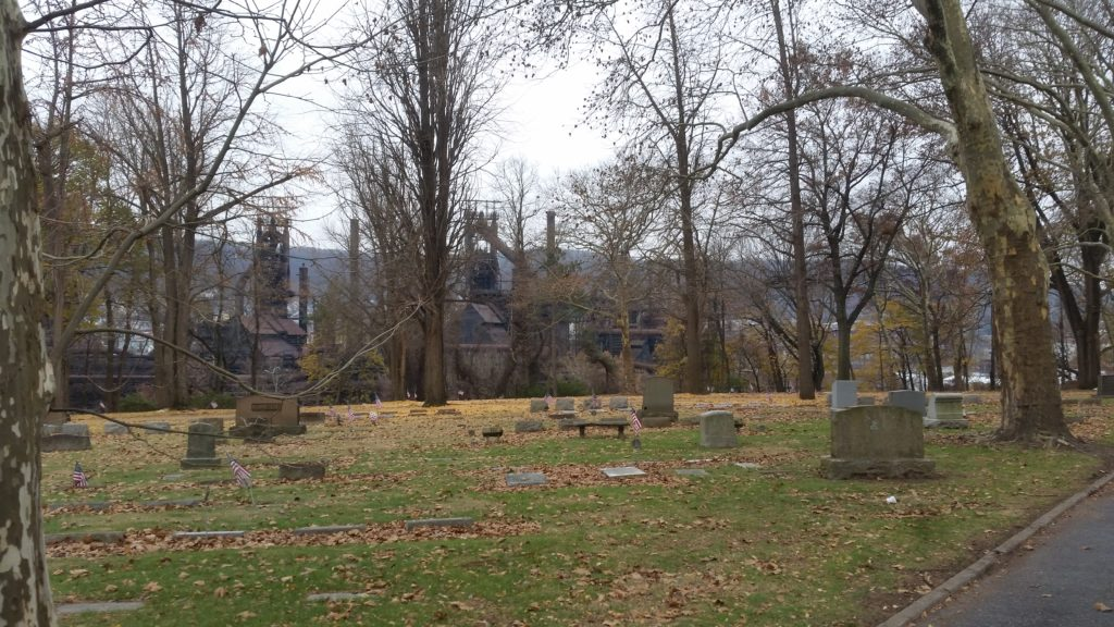 autumn cemetery scene with industry in background