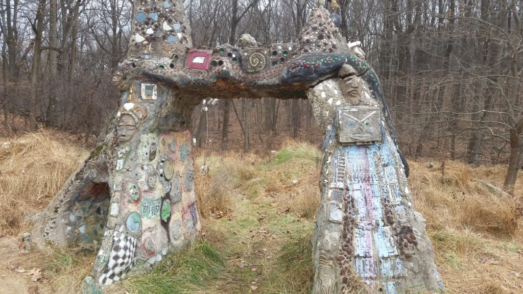 concrete arch decorated with folk art